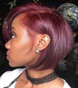 shot bob haircut styling a vibrant rasberry hair colour