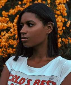 Stylish blue-black hair on a black woman